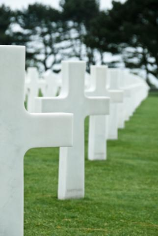 White headstones in a row at Normandy American Cemetery.