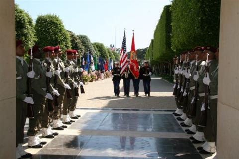 Members of the military participate in the 2012 Memorial Day ceremony at North Africa American Cemetery.