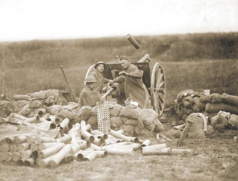 U.S. artillerymen fire 75mm gun toward Montsec from a position near Beaumont on September 12, 1918.