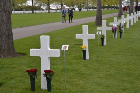 Headstones decorated with flowers and photos.